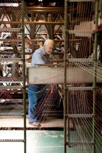 David Kline works the loom to create period-inspired textiles