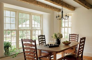 The dining room features original exposed beams.