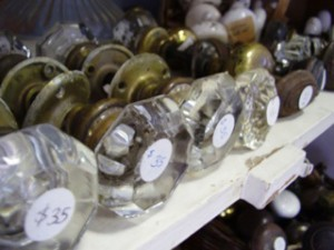 Cut glass doorknobs for sale at a salvage store.