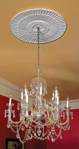 A formal medallion from Decorators Supply draws eyes to the ceiling at Washington, D.C.'s Swann House.