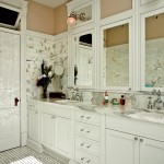 In the master bathroom, lights are mounted on mirrors that mimic the transom above the door.