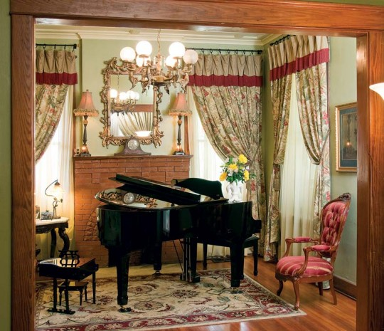 A grand piano commands attention in the music room. (The tiny replica at left is for the couple's 3-year-old grandson.)