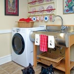 The formerly dark and dingy basement was transformed into a bright laundry room and mudroom for the couple's three pups.