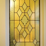 The stained glass window in the master bathroom came from Rejuvenation's Portland salvage store.
