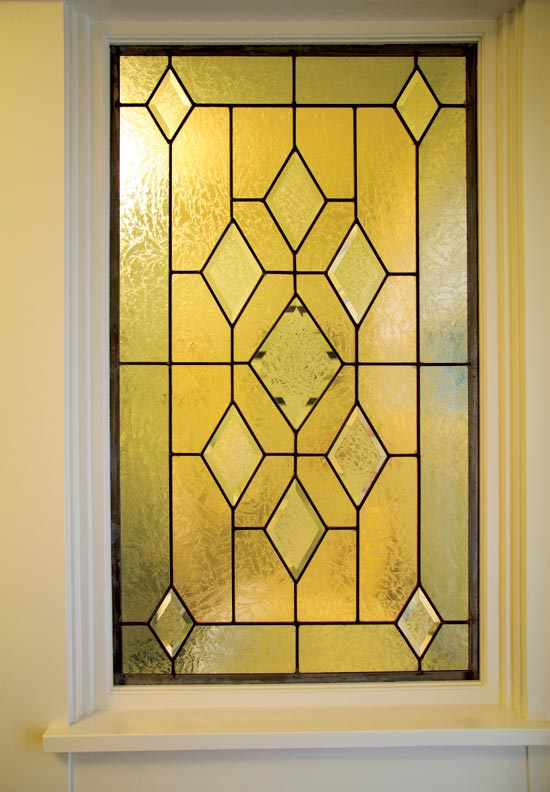 the stained glass window in the master bathroom came from rejuvenation