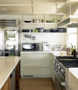 Austin Patterson Disston Architects decided against upper cabinets and instead used  open shelving to give the space a more  historical look.