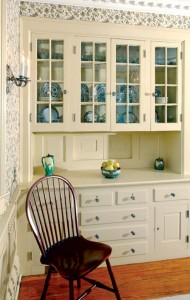 The Colonial Revival-style dining room includes a built-in buffet; the center panels slide open to provide a convenient pass-through to the pantry beyond.