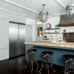 Built-in storage overtakes an entire wall in the kitchen.