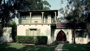 The Monterey Style's primary feature is a second-floor porch across the front of the house, recalling an early tradition in Monterey, California. This house in Pasadena also features an unusual, unadorned pointed-arch doorway.