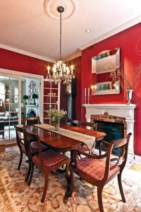 The couple fixed the dining room's sagging ceiling and livened it up with traditional red paint.