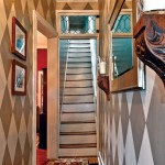 A creative paint scheme brought life to the narrow entrance hall.