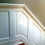 Wendy and Alex solved a stair-rail dilemma by building their own wainscot with an integrated handrail.