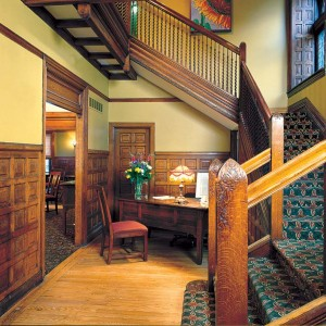 Guests check in at the Scott House, where they can enjoy the original woodwork.