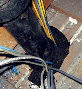 Gaps around plumbing and wiring connections were sealed with a slow-expanding foam sealer.