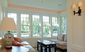 The new sunroom's double-hung nine-over-nine windows allow for better ventilation than the previous fixed Plexiglas, which often caused the room to overheat.