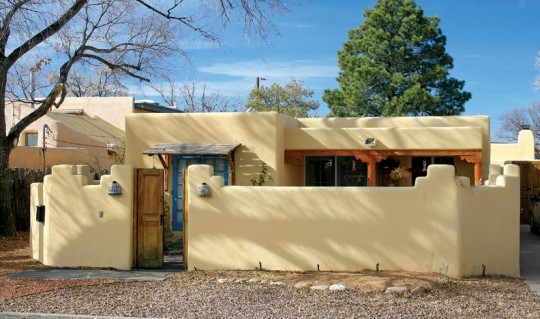 Walled front yards are a common Santa Fe feature, as in this 1950s example.