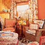 Sunset-orange walls soothe and enhance similar colors in Chinoiserie upholstery and drapery in this 1949 knotty-pine cottage. Photo: Dan Mayers
