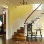 The graceful staircase is original, and cued new wainscoting and moldings.