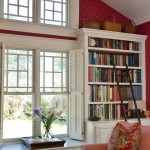 A ladder allows access to books in the family room.