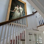 In the stair hall, a large oil painting by George Burroughs Torrey depicts the daughters of Henry Seligman, a New York banker.