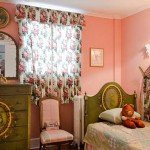 "Pink with rosebuds, the little girls' room, originally the ""birthing room,"" boasts a suite of antique paint-decorated furniture."