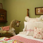A daughter's bedroom with vintage linens and an old rocking horse.
