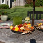 A seafood boil is ready on the patio.