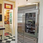 The stainless steel fridge is Doug's one ultra-modern indulgence—but the evolved-over-time aesthetic of the kitchen helps explain it.