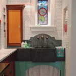 Nooks on either side of the soapstone sink hold vintage canisters and dish towels.