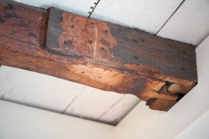 Scabs are visible on some of the dining-room beams, which were cut to modernize the house.