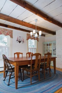 Exposed beams in the dining room offer clues to the house's original configuration.