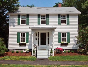The Federal house in Exeter, New Hampshire, was augmented with a Victorian-style porch, likely in the 1860s.
