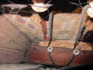 In the foyer ceiling in front of the staircase (top), Kerry discovered this Victorian-era wallpaper (bottom)—evidence that the stairs and ceiling were likely later additions. (Further evidence on the dining room ceiling hints at the previous location of the staircase.)