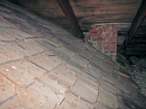 In the attic above the kitchen ell are two previous roofs. The first (middle) is fully intact and appears to date to the 1850s, while the shallower framing inside it (bottom) is likely pre-1820s.