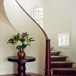 A curved staircase leads to guest bedrooms.