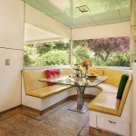 The sleek 1940s kitchen is remarkably intact, with a curved leather banquette.
