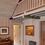 The upstairs hall is carried on exposed rafters and open to the great room below.