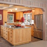Terracotta-colored walls define the kitchen area (which absorbed an old pantry).