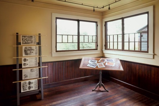 The Painting Room sports refurbished beadboard wainscoting; this section of the room highlights Winslow Homer's career as  an illustrator.