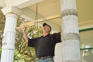 Getting everything plumb and level was critical when installing the porch columns and their bases. Marty's team meticulously checked measurements during each step of the process.