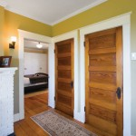 Clean-lined Craftsman details, like these five-panel doors, abound throughout the home.