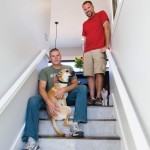 Homeowners Marek Ulicny and Dan Rice with two of their many furry friends.