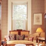 Hand-blocked ashlar wallpaper—a popular 19th-century treatment—enlivens the hallway.