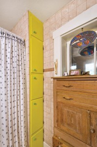 Salvageable elements of the kitchen cabinets were repurposed in the bathroom.