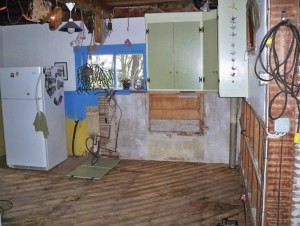 Floodwaters damaged the kitchen cabinets beyond repair.