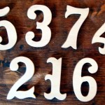 Echo your Victorian house's gingerbread woodwork with scrolled wood numbers from The Victorian Woodshop.