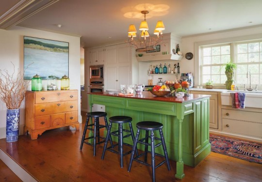 The starring element of the new kitchen is the large center island finished in green milk paint.