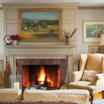 The sitting area of the new kitchen/dining/family room features a handsomely paneled fireplace wall. Over the mantel, a rural idyll painted by Vermont artist Brian Sweetland features cows.