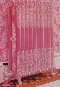 A radiator appears as a 3-D version of the wallpaper and shows why polychroming became a popular technique for making radiators blend in.