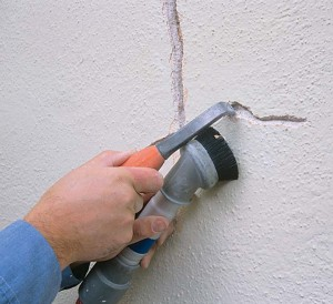 Cyclical cracks are the bane of antique walls and must be repaired with care to avoid reoccurence. First, dig out the crack in an inverted V (top) that undercuts the plaster, vacuuming out all debris.